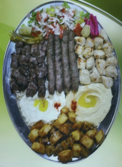 4 Skewers Chicken, 4 Skewers Beef, 4 Skewers Kafta(Ground Beef, Parsley, Onions, and Spices) plus all sides shown in photo...$64.00