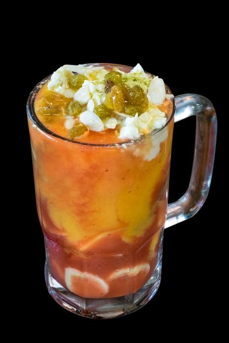 COPA CABANA: Slices of Banana, Strawberry, and Mango with Mango Juice and Strawberry Juice..... $7.99